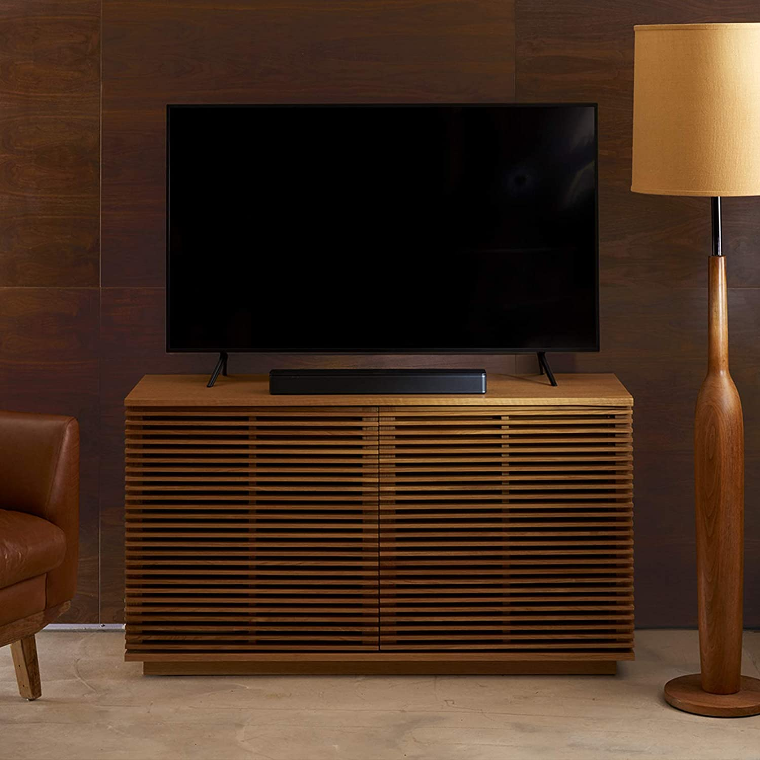 Bose TV speaker in a wooden cabinet