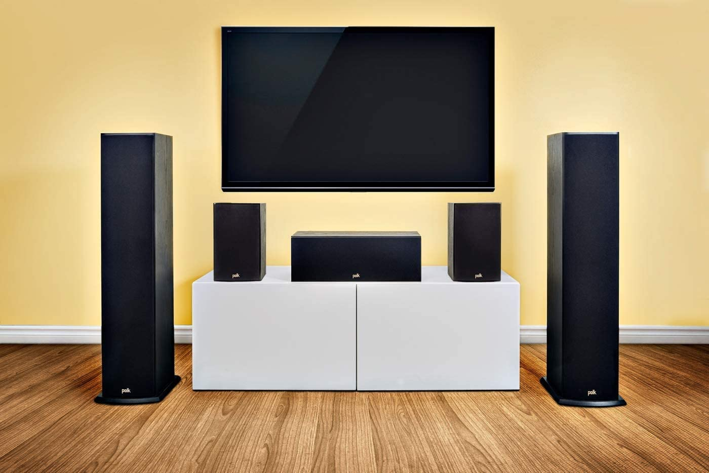 Speaker set in a living room with yellow walls