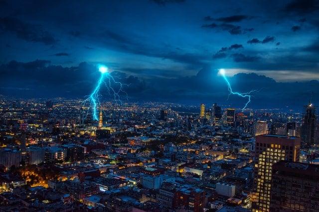 lightning striking at night in the city