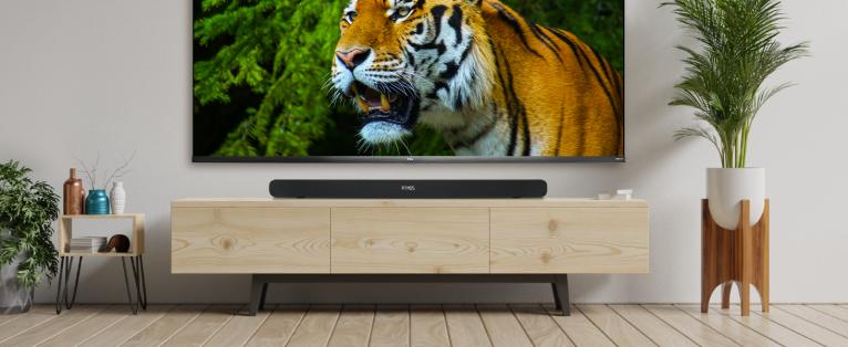 TCL Alto 8i placed below a tv