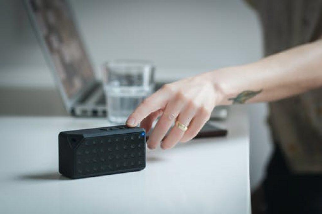 Black rectangular speaker on a white surface