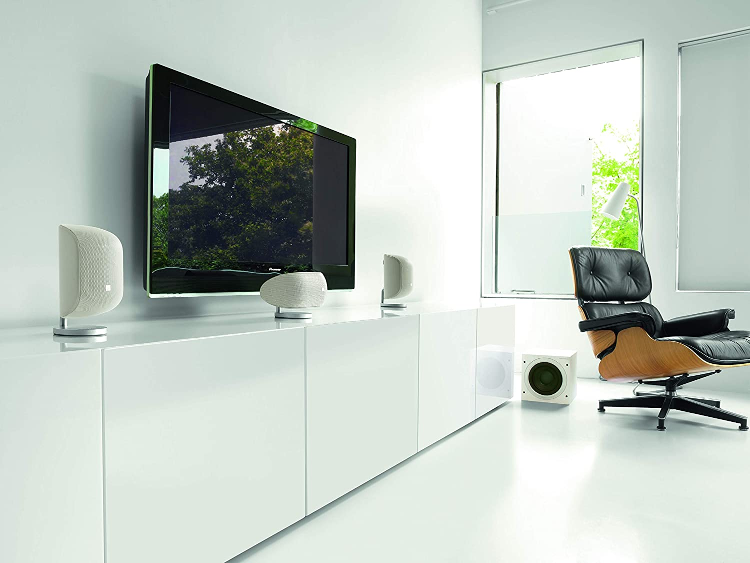 white Bowers & Wilkins ASW608 at the corner of the room