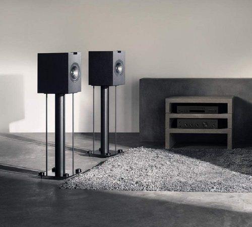 KEF Q150 bookshelf speakers beside a table
