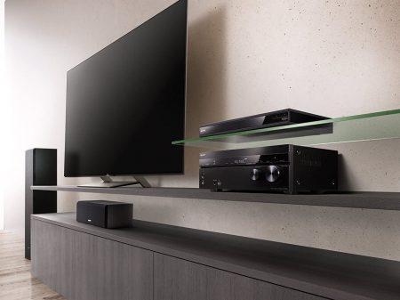 Sony STR-DN1080 7.2 ch Surround Sound Home Theater AV Receiver displayed beside a tv
