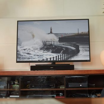 Bose Solo 15 Series placed below a tv in a living room