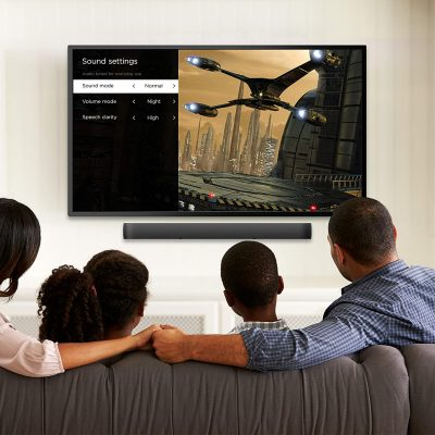Family watching the tv with audio from Roku Smart Soundbar