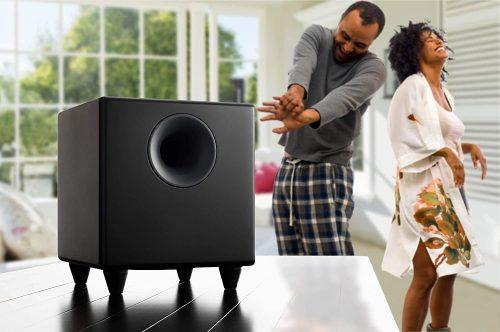 Man and woman enjoying listening to music