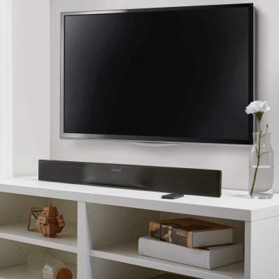 Blackweb soundbar below a tv