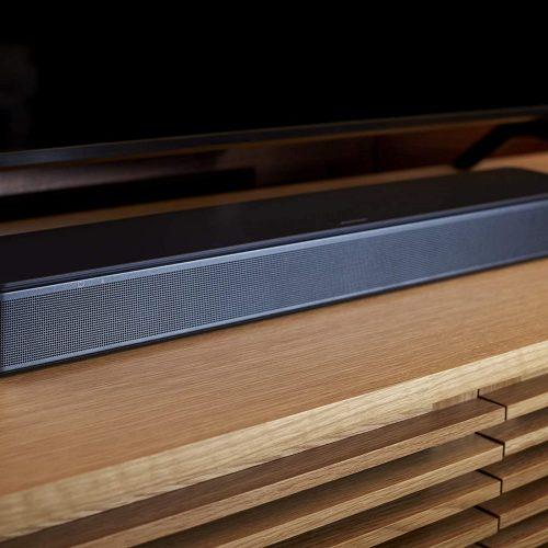 Bose TV speaker close up shot in wooden shelf