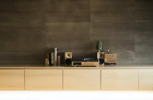 Brown and black speaker on brown shelf