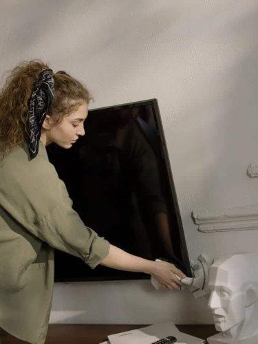 Girl Checking Samsung TV