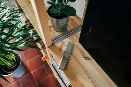Remote on television shelf