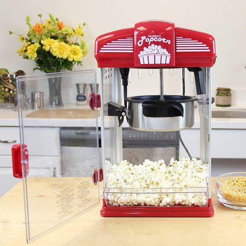 West Bend Hot Oil Theater Style Popcorn Popper Machine placed on a kitchen table