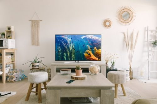 colorful flat screen TV in a white living room
