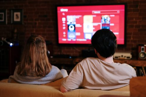 couple sitting in front of TV