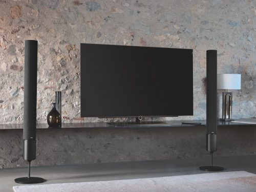 flat screen tv and black tower speakers