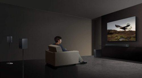 man watching TV while using Samsung soundbar