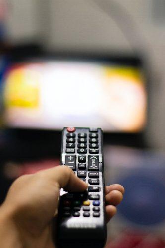 person holding a remote control