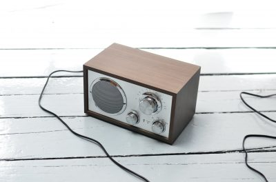 brown radio speaker on a wooden surface