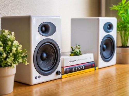 white speakers on wooden surface