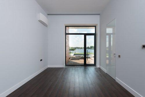 white base moldings on dark brown floors