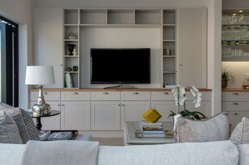 white living room with flat screen TV in the center