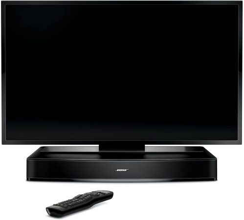 Bose Solo 15 Series II placed below a tv with remote