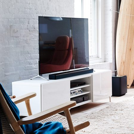 Bose SoundTouch 300 Soundbar above a living room table, baside a tv