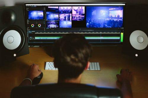 Man editing in a computer with soundbar
