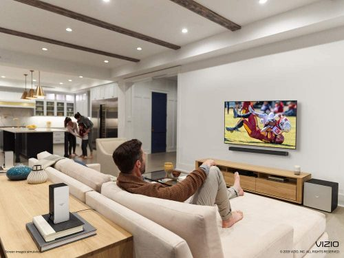 Man watching game in a tv with VIZIO SB46514-F6