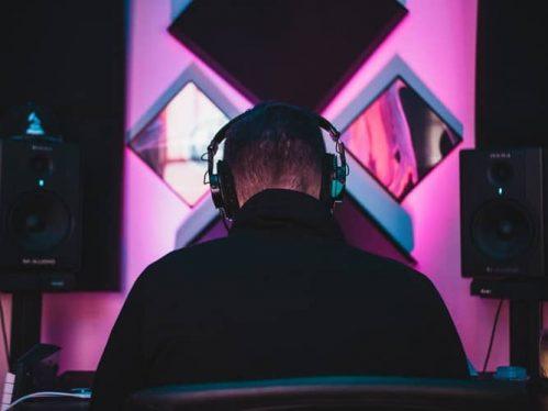 Man wearing earphones with soundbar surround