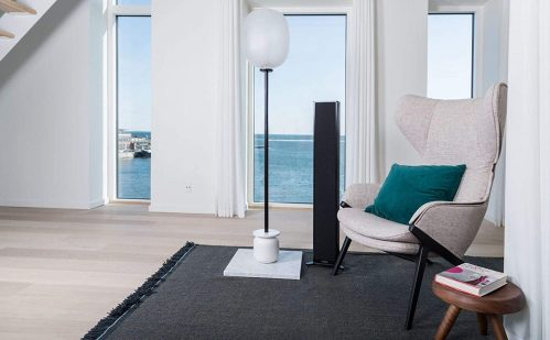 Piega Premium 501 Wireless Floor-Standing Speakers And Sofa In A Room