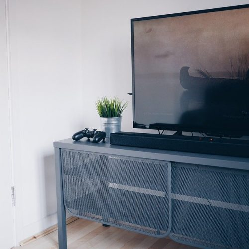TV on a table beside a console controller