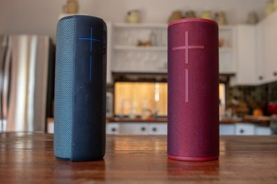 Blue and red portable speakers in a living room set up