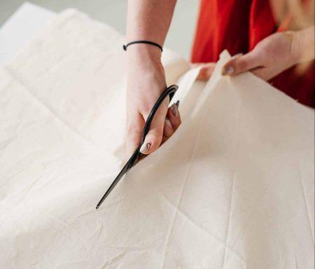 cutting white cloth