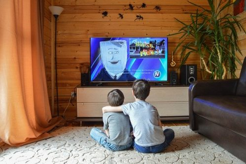 two boys watching children's program
